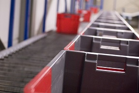 Crates on a conveyer belt in a distribution warehouse