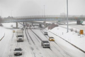 Motorist drive along a snow covered Interstate-94 in Detroit