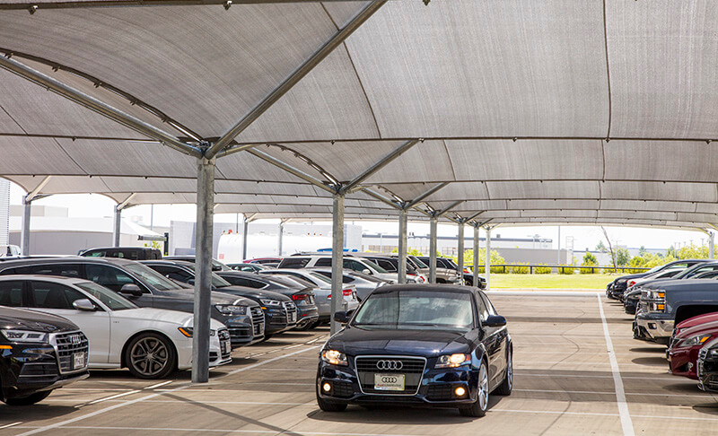 Audi vehicles under protective canopy