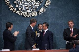 Harald Kruger (L) and Enrique Nieto, president (R)