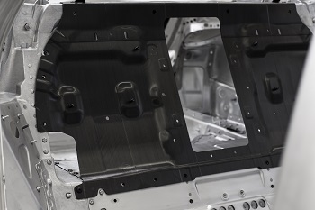 The CFRP rear panel is the largest component in the new A8's occupant cell