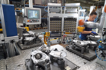 BMW has successfully introduced a collaborative robot into a transmission assembly station at its Dingolfing plant
