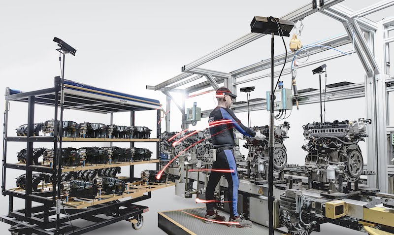 Ford is hoping to improve workstation design using data gathered from workers wearing suits equipped with body tracking technology at its engine assembly plant in Valencia, Spain
